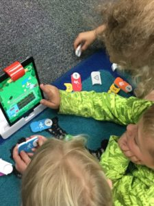 Student's Using OSMO Coding Kits